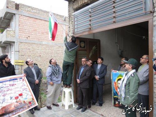 نصب پرچم اجلاسیه 4000شهید گلستان درب منازل خانواده شهدای گالیکش